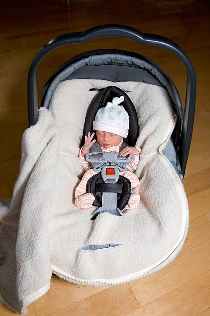 Photo of a premature infant in a carseat