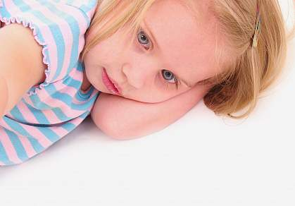 Photo of a young girl staring away from the camera