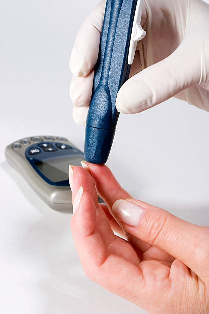 Photo of a person administering a blood glucose test