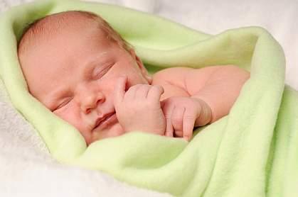 Photo of newborn baby sleeping peacefully