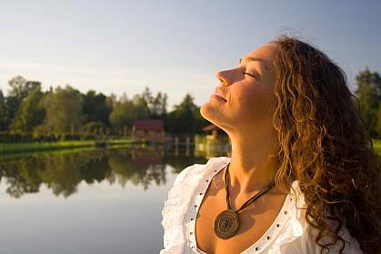 Photo of woman taking a deep breath