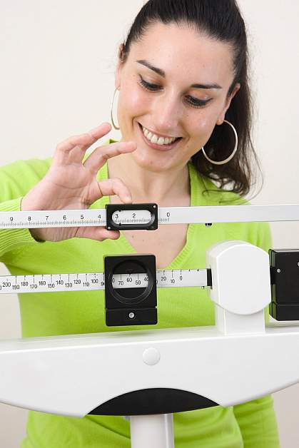 Photo of woman on a scale