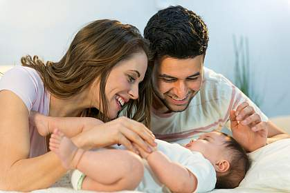 Photo of a woman, a man, and a baby