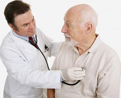 Photo of an older man and a physician