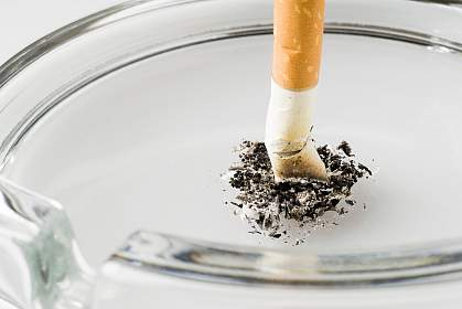 Photo of a cigarette stubbed out in an ashtray