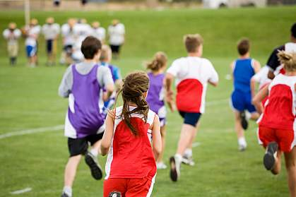 Photo of a group of tweens running