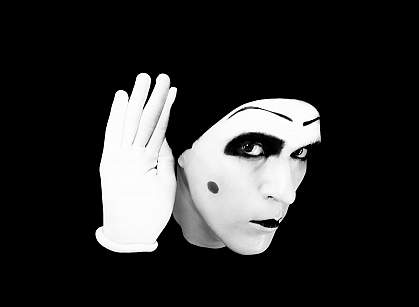 a photo of a mime holding his hand to his ear