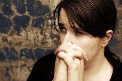 photo of woman looking worried
