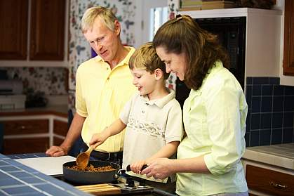 Photo of a family cooking