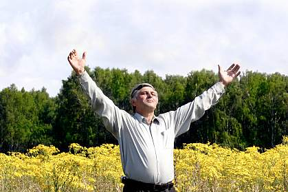 Photo of a man standing in a field