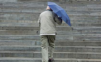 Photo of a man climbing stairs