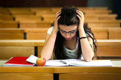 Photo of a young woman studying