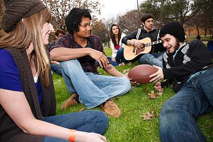 Photo of college students gathered on a lawn