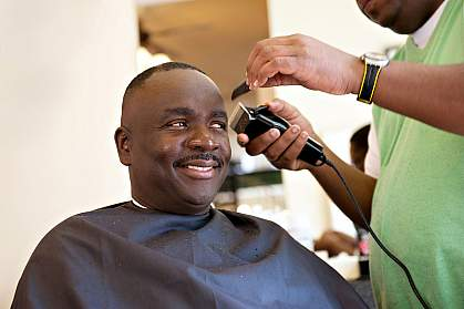 Photo of an African American man at the barber