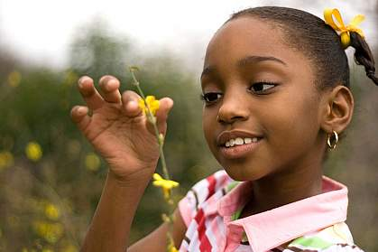 Photo of a little girl holding a flower