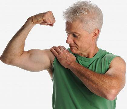 Photo of an older man flexing large biceps