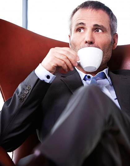 Photo of a man drinking coffee