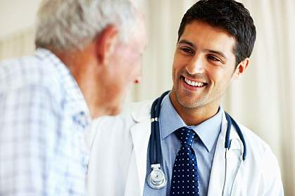 Photo of an older man talking with his doctor