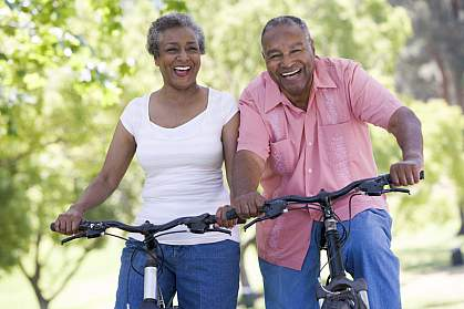 Photo of senior couple bike riding
