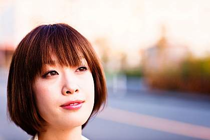 Photo of an optimistic young Japanese woman