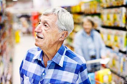 Photo of a confused man in a grocery store