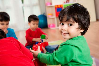 Boy playing with toy block.