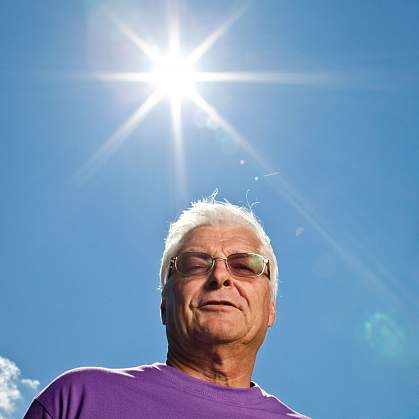 Older man with blazing sun.