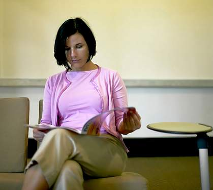 A woman sitting in a waiting room.