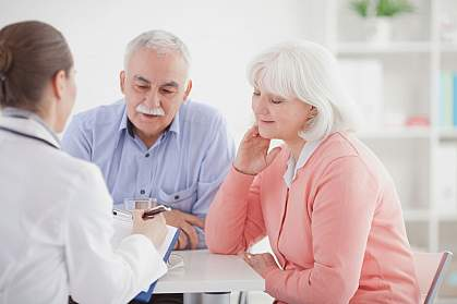 Older couple consulting with a doctor.