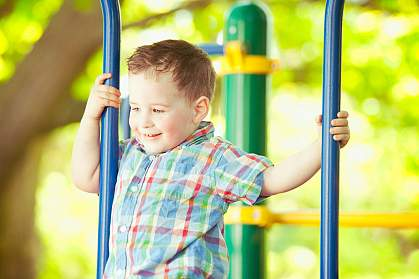 Boy playing at the park.