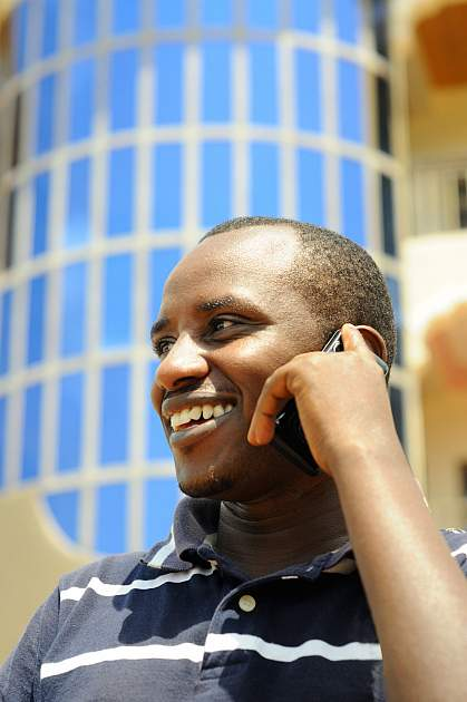 African man using a mobile phone.