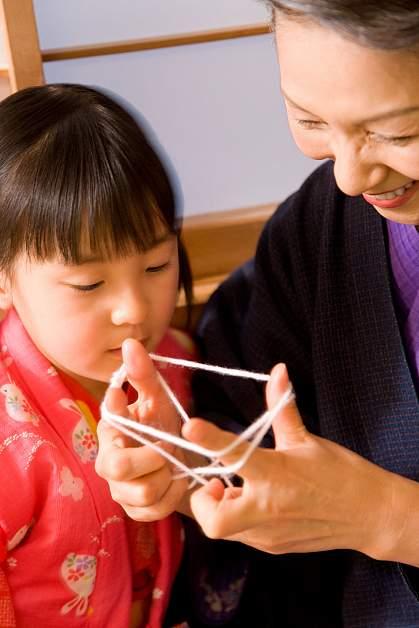 Female Asian senior citizen and her granddaughter.