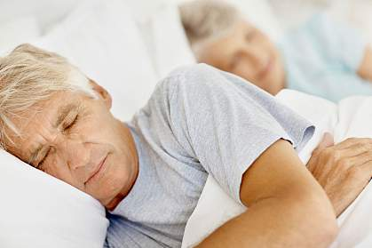 Photo of an elderly couple asleep.