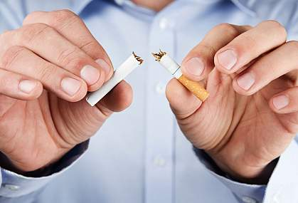 Photo of a person breaking a cigarette.