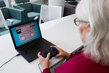 Older woman playing a computer game