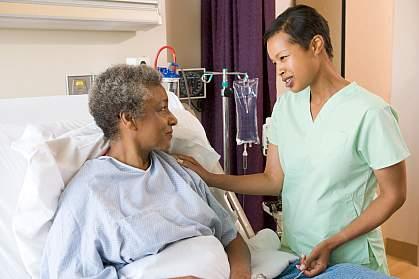 Nurse helping hospital patient.