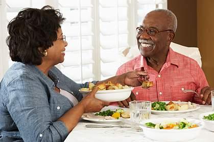 Senior couple enjoying a meal at home.