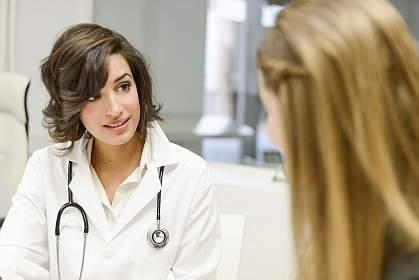 A doctor speaking with a patient