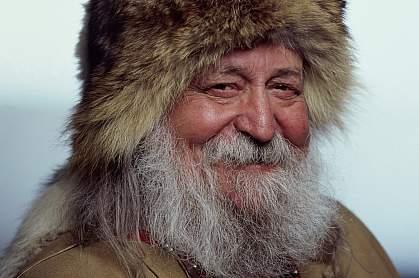 Portrait of a senior Inuit man smiling.