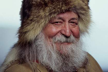 Portrait of a senior Inuit man smiling.