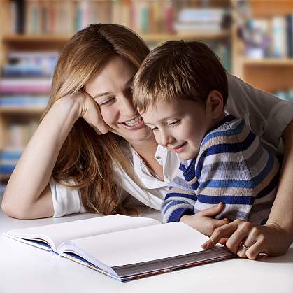 A mother and young son enjoying reading time.