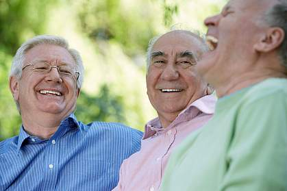Three senior men laughing