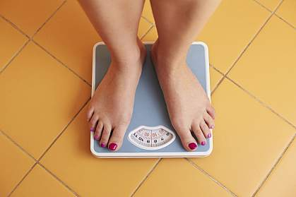 Young woman's feet on a bathroom scale