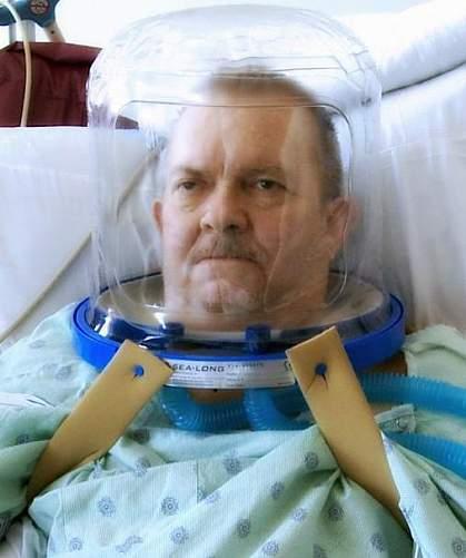 Man in ventilation helmet