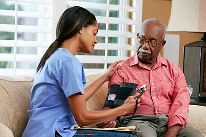 Nurse taking senior man's blood pressure.