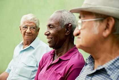 Senior men sitting in the park.