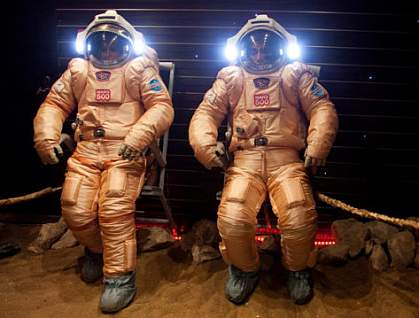 Crew members in spacesuits