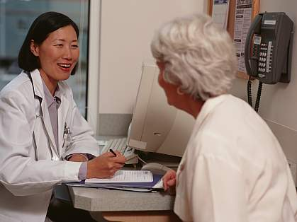 Senior woman speaking with a doctor.