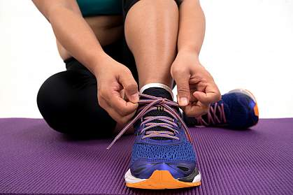 Woman tying running shoe laces