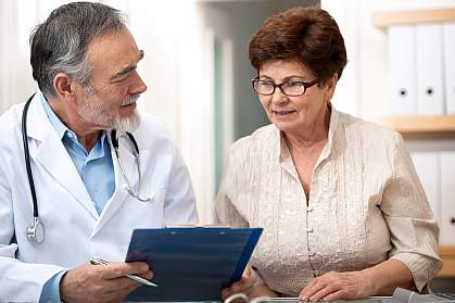 Doctor talking to female senior patient